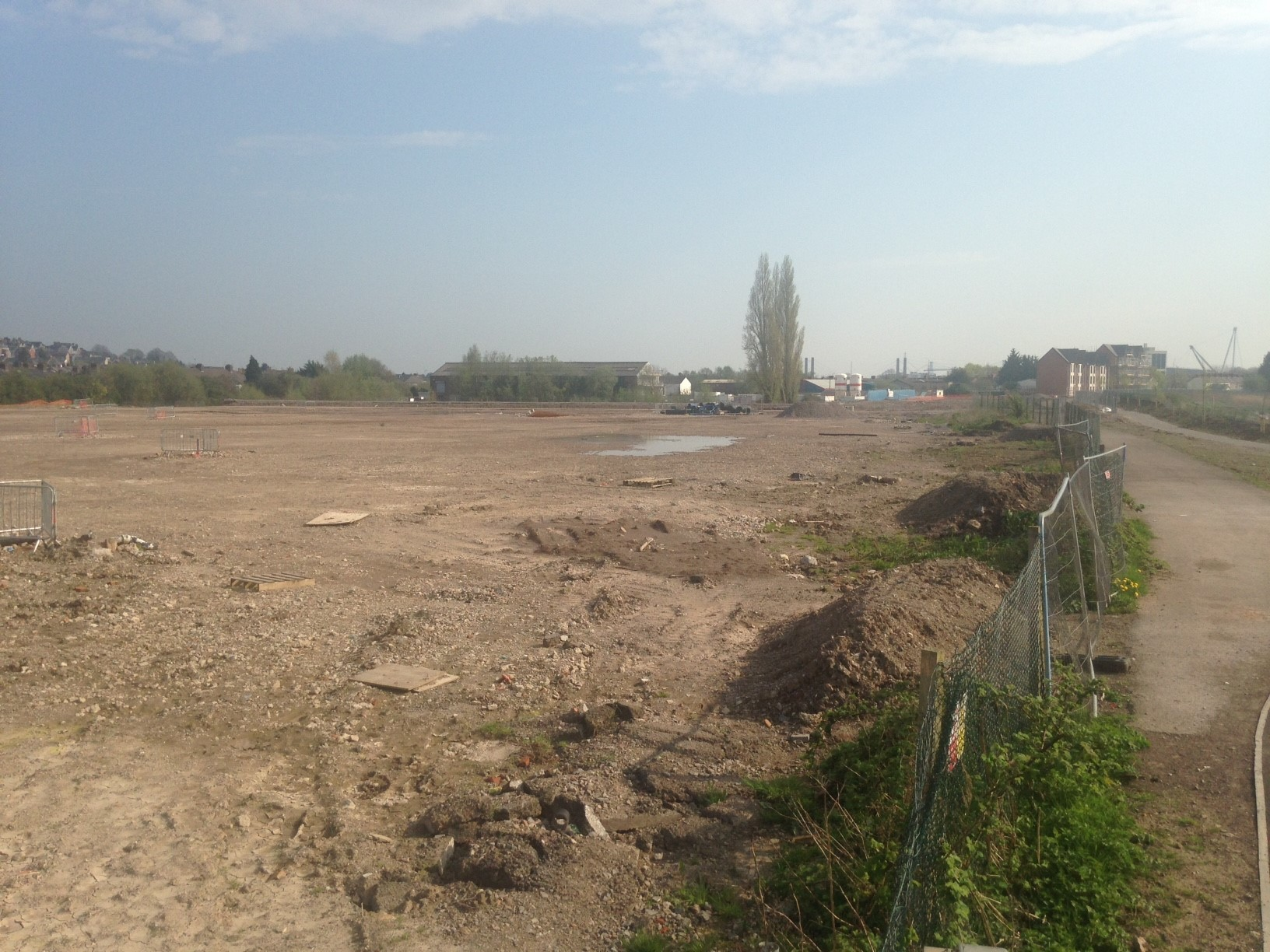 The development site, looking south from the rear of Glan Usk primary school. The flats (far right) built as phase one of the original scheme will be incorporated into updated one.