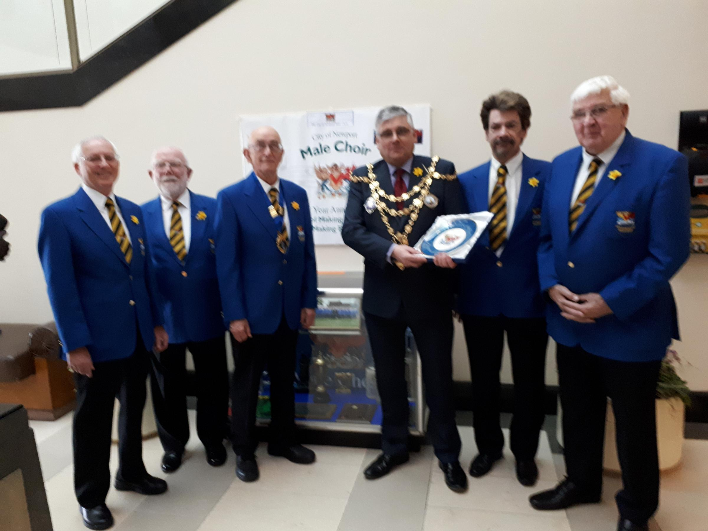 UNVEILING: Mayor of Newport, Cllr David Fouweather, unveils a display at Newport Civic Centre to mark Newport Male Choir's 75th anniversary year