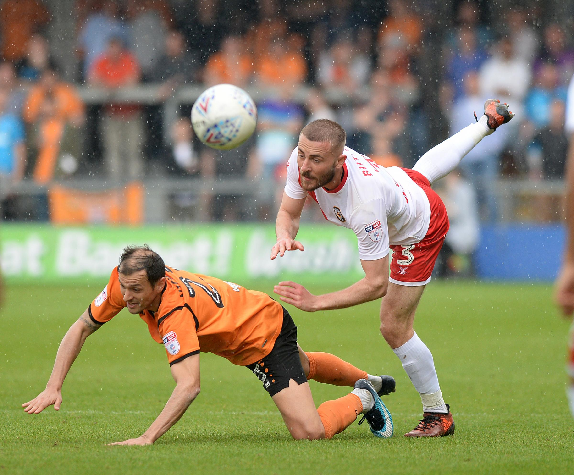 TUSSLE: Newport County defender Dan Butler in action at Barnet on Saturday. Pictures: Huw Evans Agency