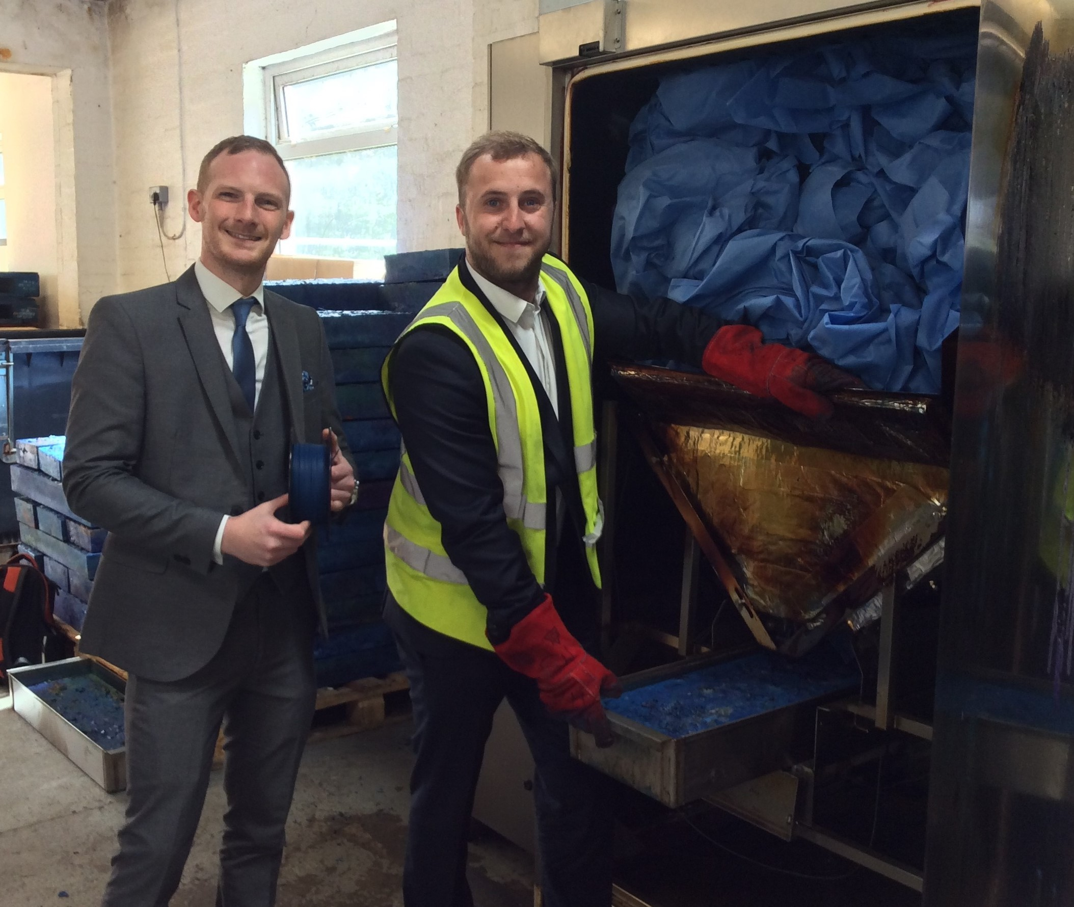 IT'S A WRAP: Dr Ashley Pursglove (left) with 3D printer filament produced from waste medical wrapping, and Thomas Davison-Sebry, sales and marketing director for TCG, show off the Sterimelt machine at St Woolos Hospital
