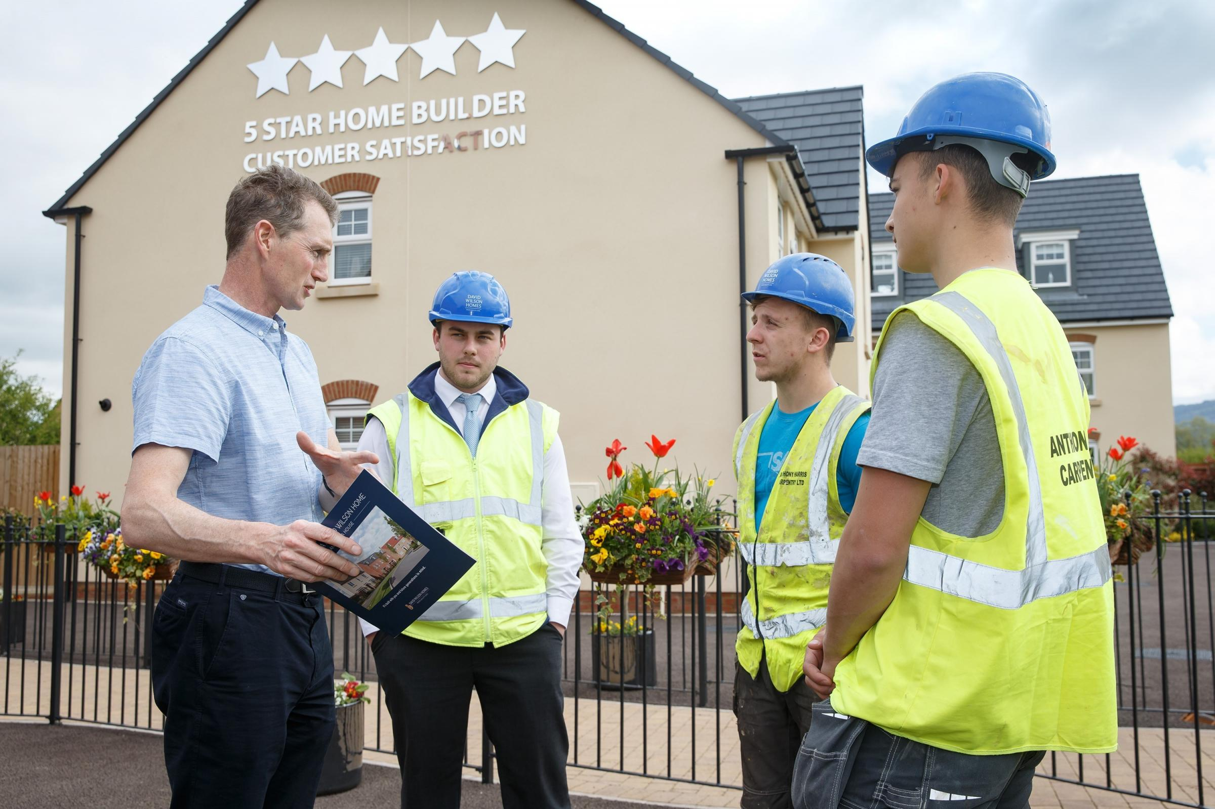 Monmouth MP David Davies on a tour of the Kings Gate Wood development with trainee assistant site manager Nick Jones (centre) and apprentices