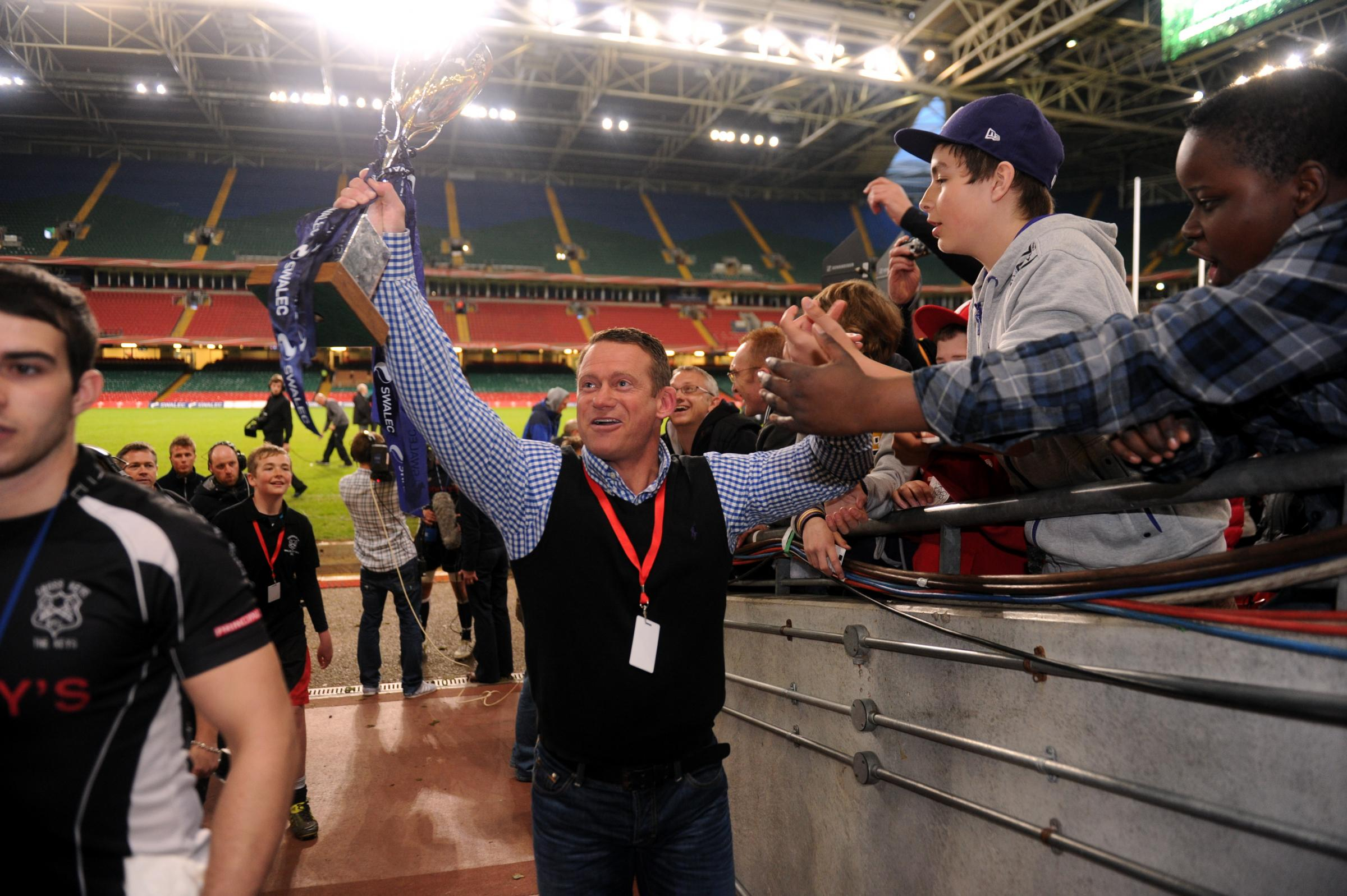 WINNERS: Cross Keys director of rugby Jonathan Westwood lifts the WRU National Cup in 2012