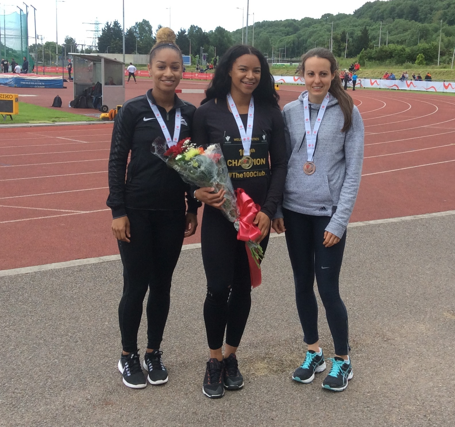 SPRINT SUCCESS: Mica Moore, centre, celebrates her 100m victory at last summer's Welsh Championships