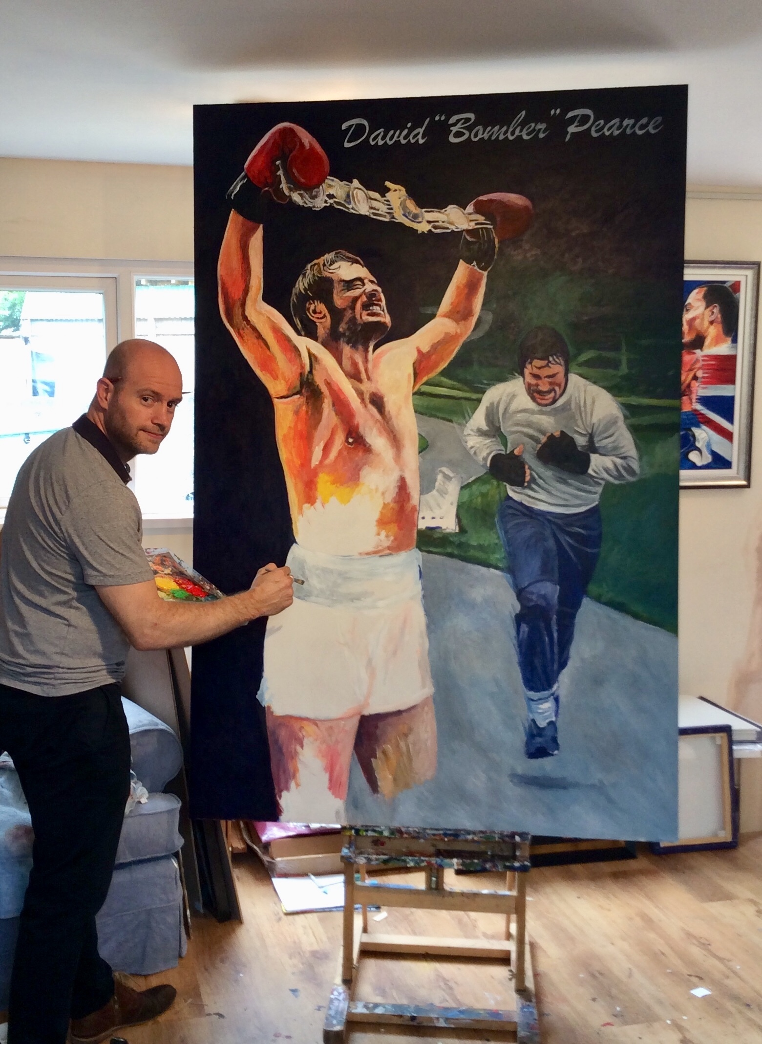 UNVEILING: Artist Pat Killian by the painting of boxer David Pearce which is to be unveiled