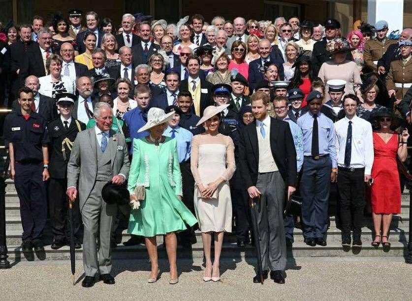 ROYALTY: Attendees at the garden party, with canon Mark Soady top left