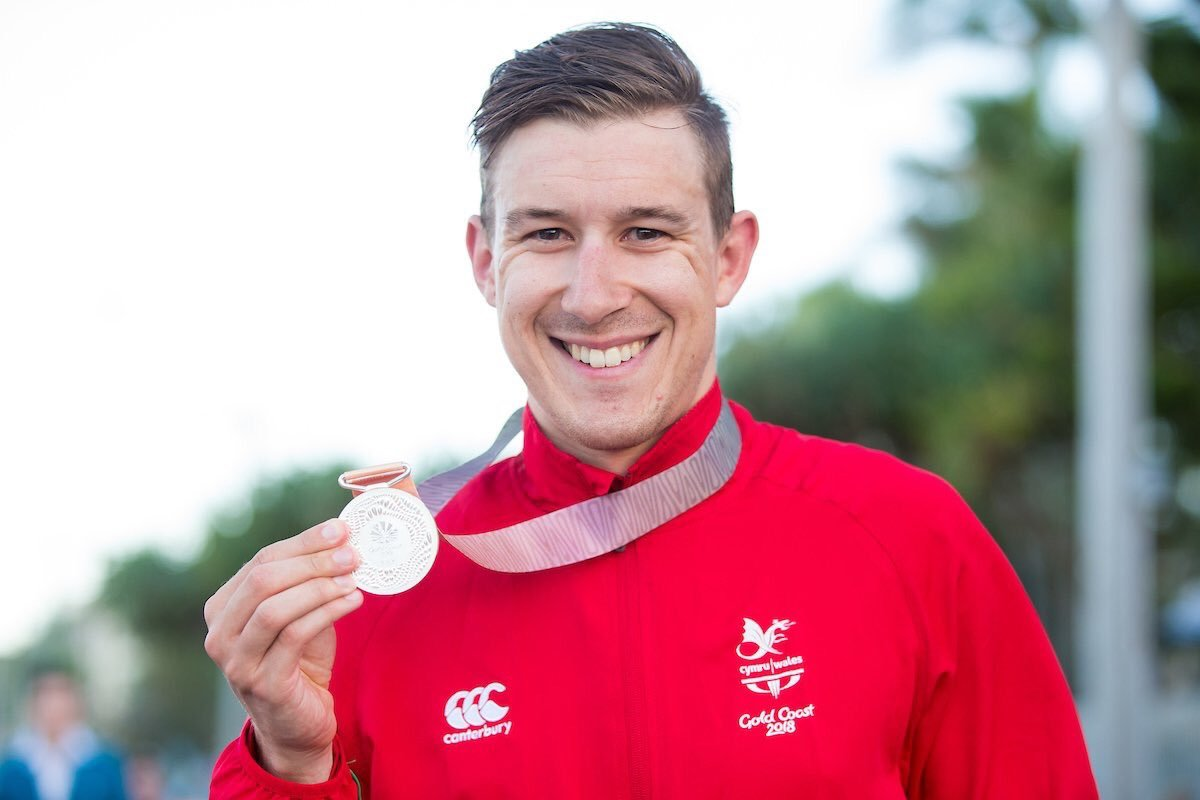 SILVER LINING: Jon Mould with his silver medal from the men's road race at the Gold Coast Commonwealth Games