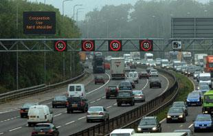 Delays on M4 after lorry hits bridge