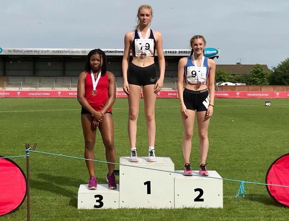 TOP SPOT: Caitlyn Mapps, centre, was crowned under-17 100m and long jump champion in Newport