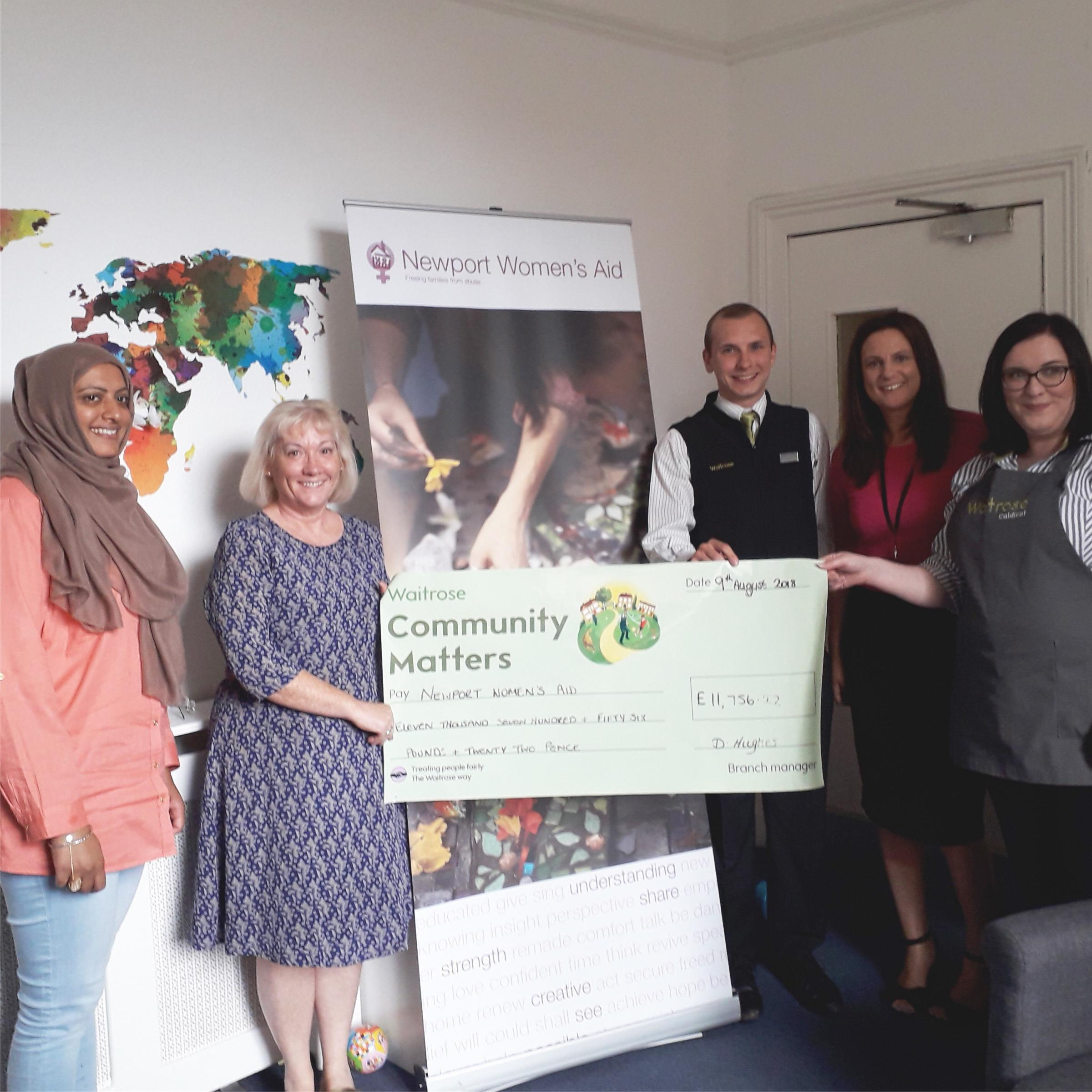 MONEY: Waitrose staff handing over a cheque to Newport Women's Aid