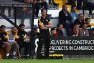 SATISFACTION: Newport County manager Michael Flynn watches the action at Cambridge United last night. Picture: Huw Evans Agency