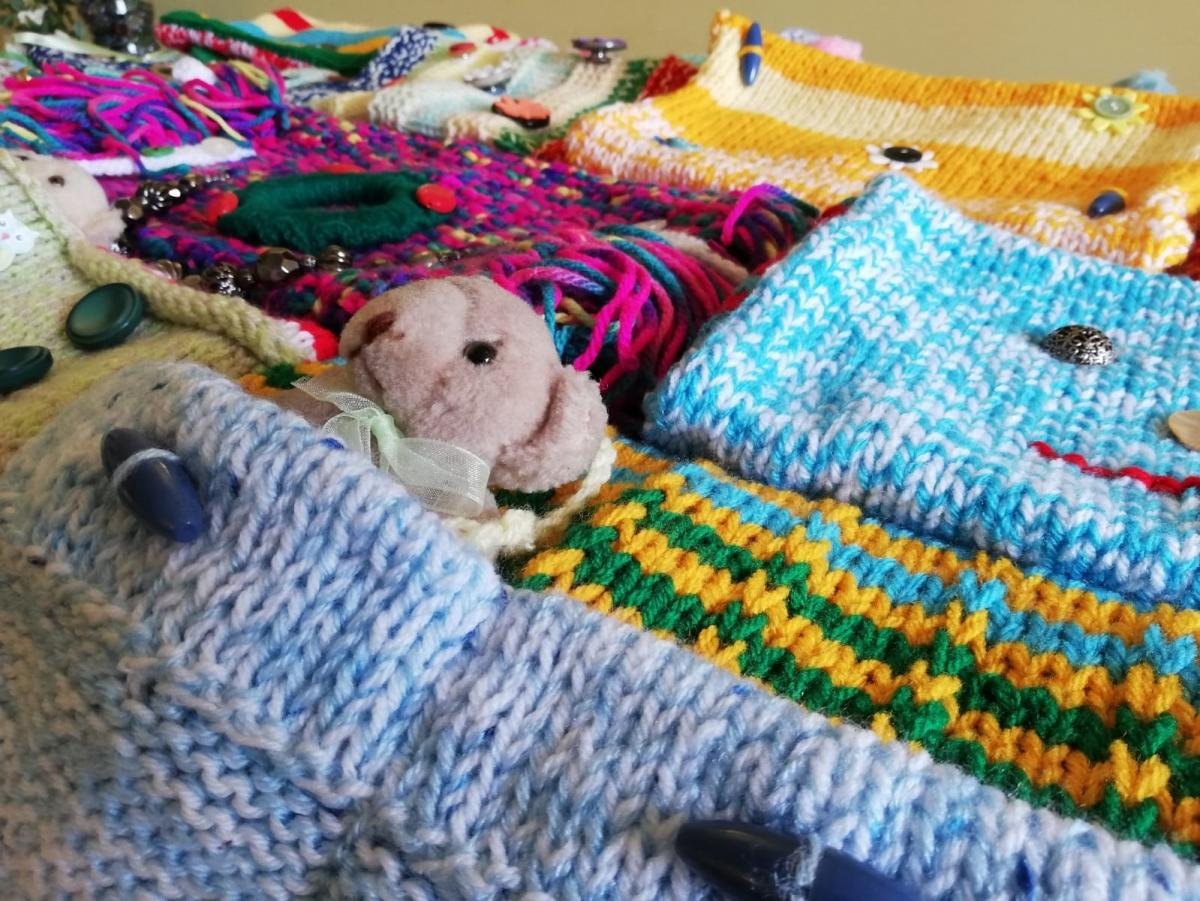 Abicare staff gift Royal Gwent Hospital twiddle muffs for dementia patients