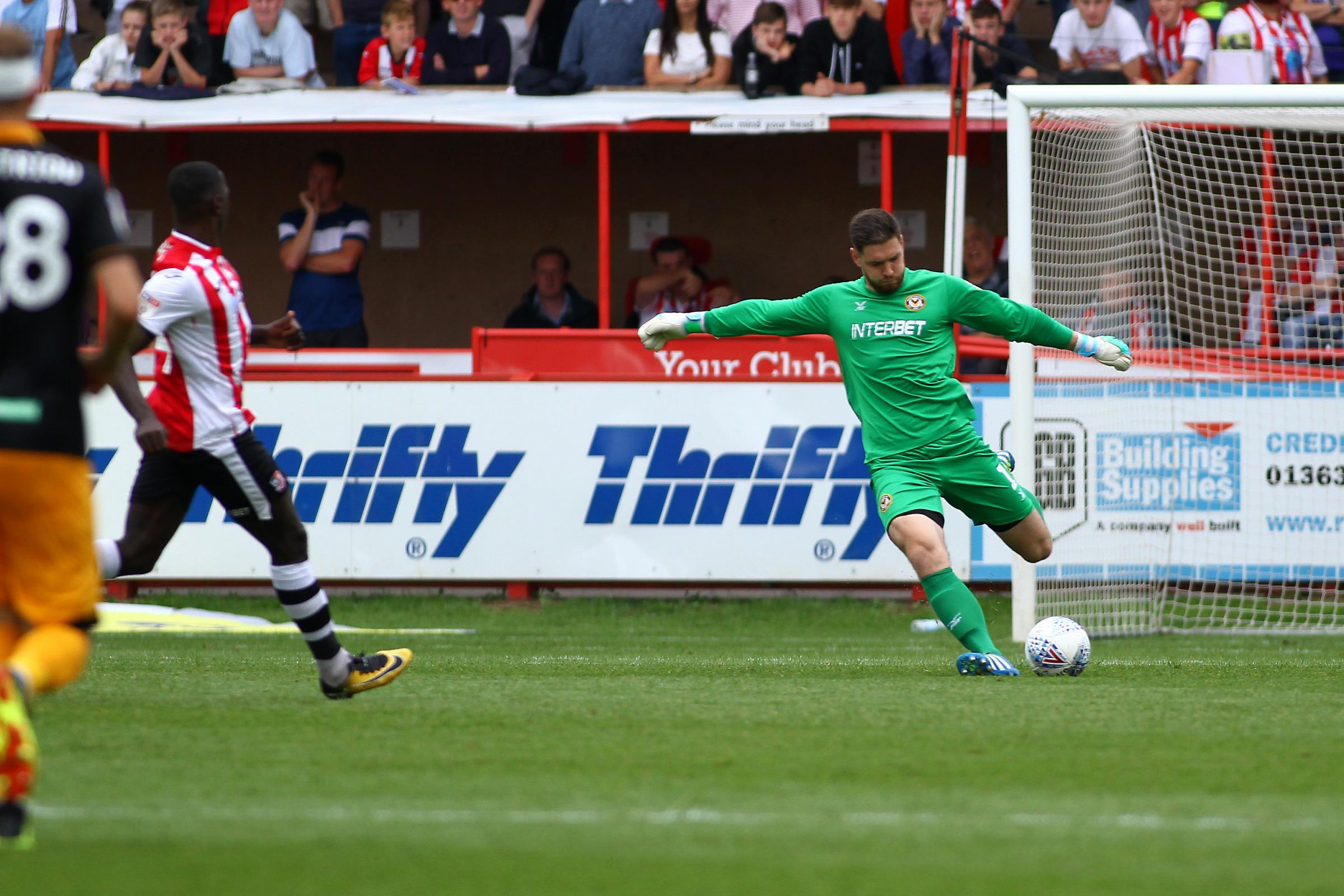 INSPIRED: Newport County goalkeeper Joe Day clears the danger at Exeter City on Saturday. Picture: Huw Evans Agency