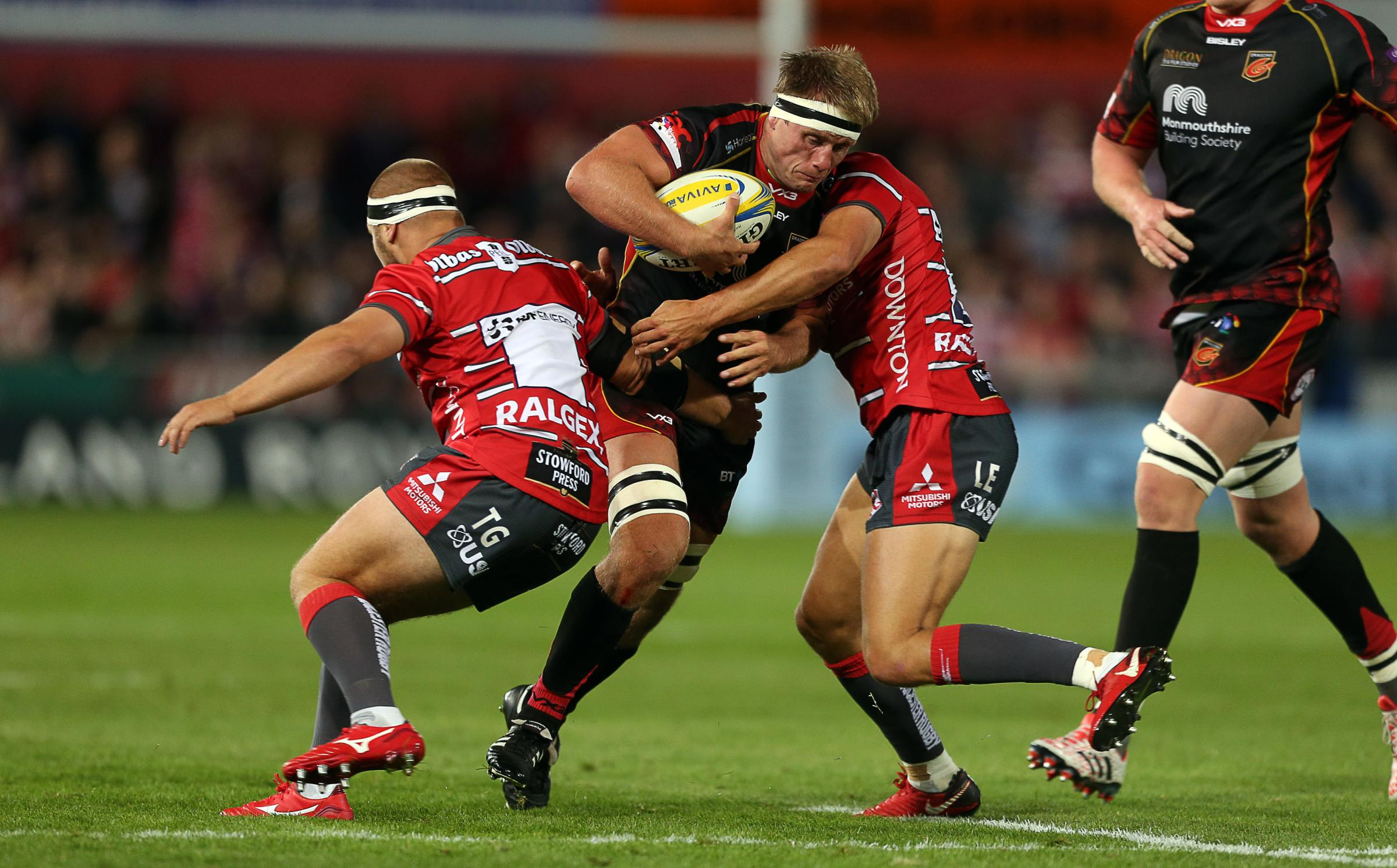 23.08.18 - Gloucester Rugby v Dragons - Pre Season Friendly - Nic Cudd of Dragons is tackled by Lloyd Evans of Gloucester..