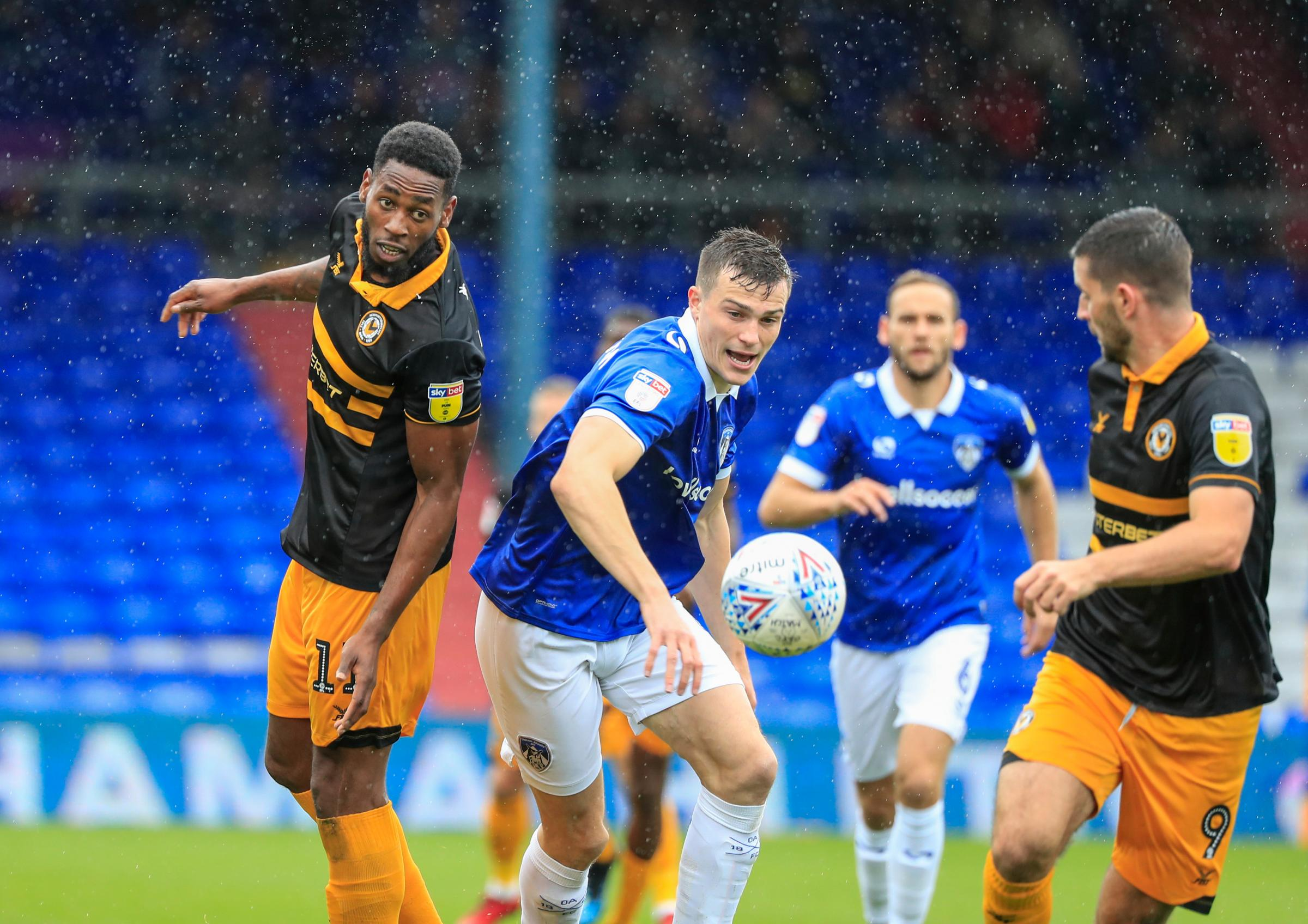 STRUGGLING: Newport County strikers Jamille Matt, left, and Padraig Amond, right, played with injury problems at Oldham Athletic. Pictures: Huw Evans Agency