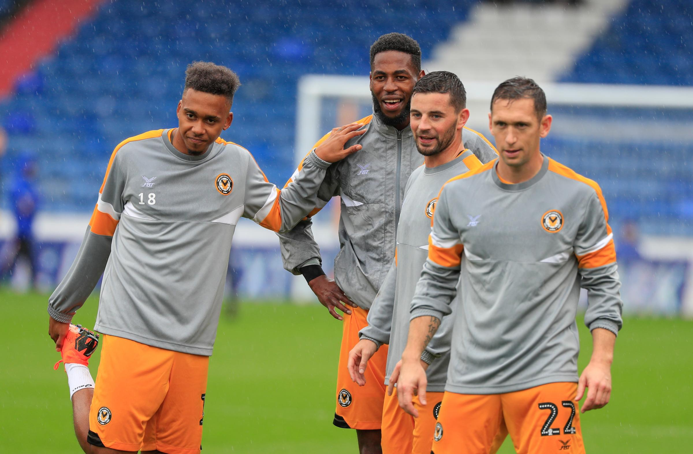 SPIRIT: Newport County forwards Keanu Marsh-Brown, Jamille Matt and Padraig Amond with captain Andrew Crofts at Boundary Park on Saturday