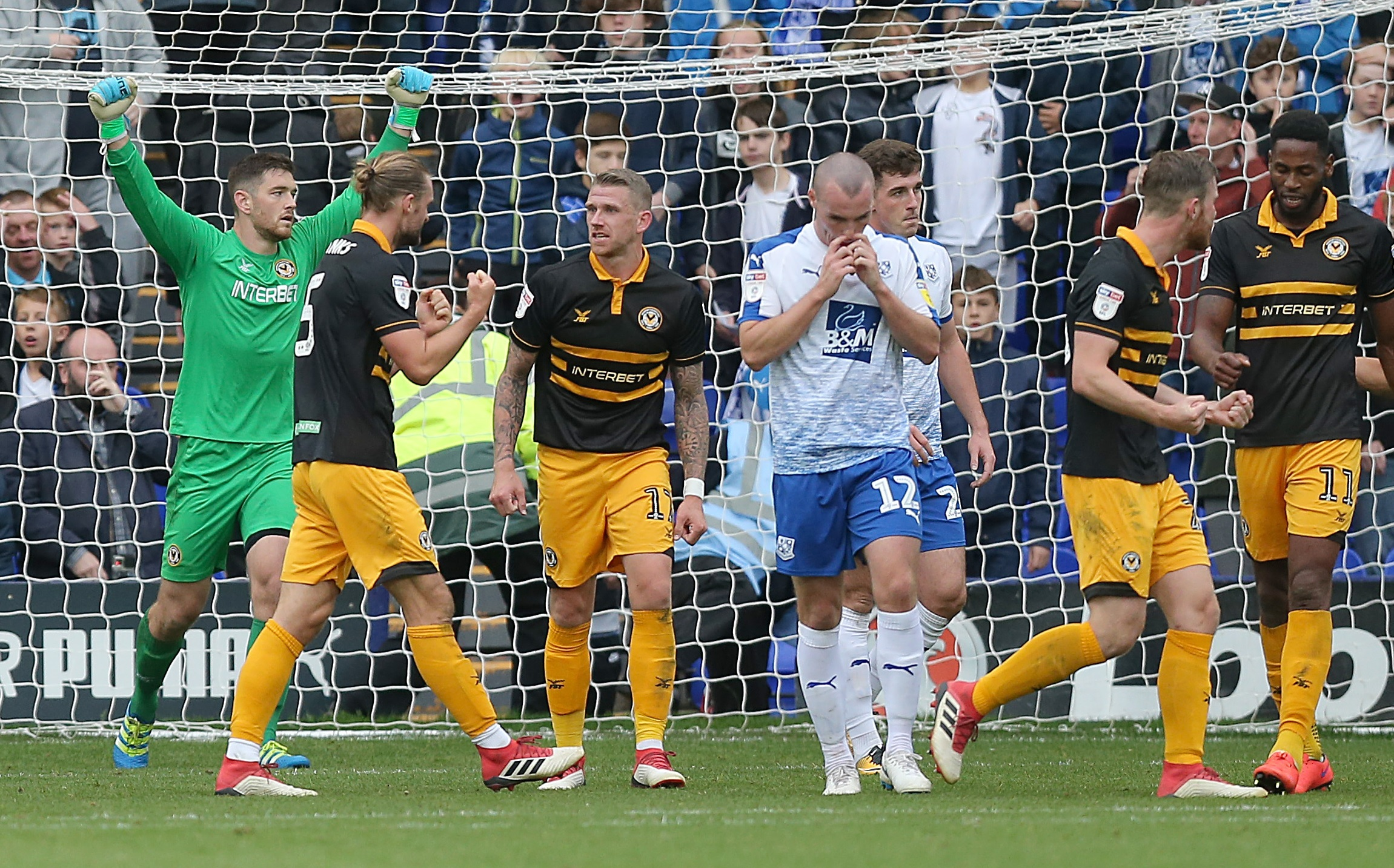 JOY: Joe Day, left, and his Newport County teammates celebrate victory at Tranmere Rovers. Picture: Huw Evans Agency