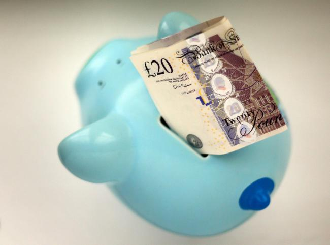 File photo dated 06/01/15 of money in a piggy bank. Pension savers' money will have stronger protections as a new law to drive up standards in schemes used by millions of people to save for retirement has come into force. PRESS ASSOCIATION Photo. Issu