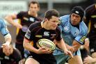 Rhodri Gomer-Davies tries to evade the Blues' Maama Molitika