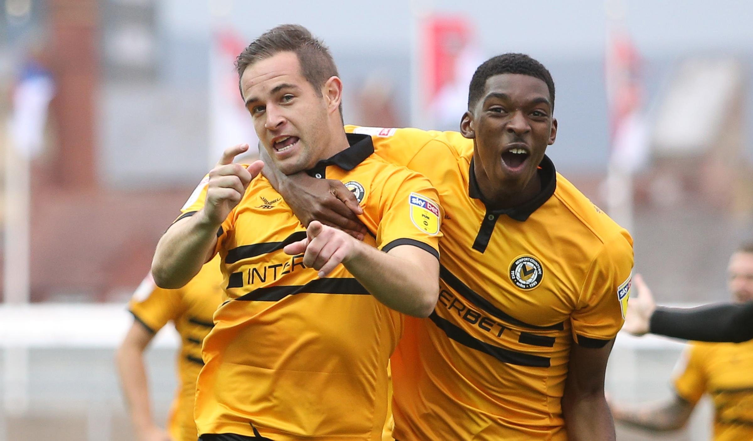 SCREAMER: Matty Dolan, left, celebrates his super strike against Stevenage with Newport County teammate Tyreeq Bakinson. Picture: Huw Evans Agency