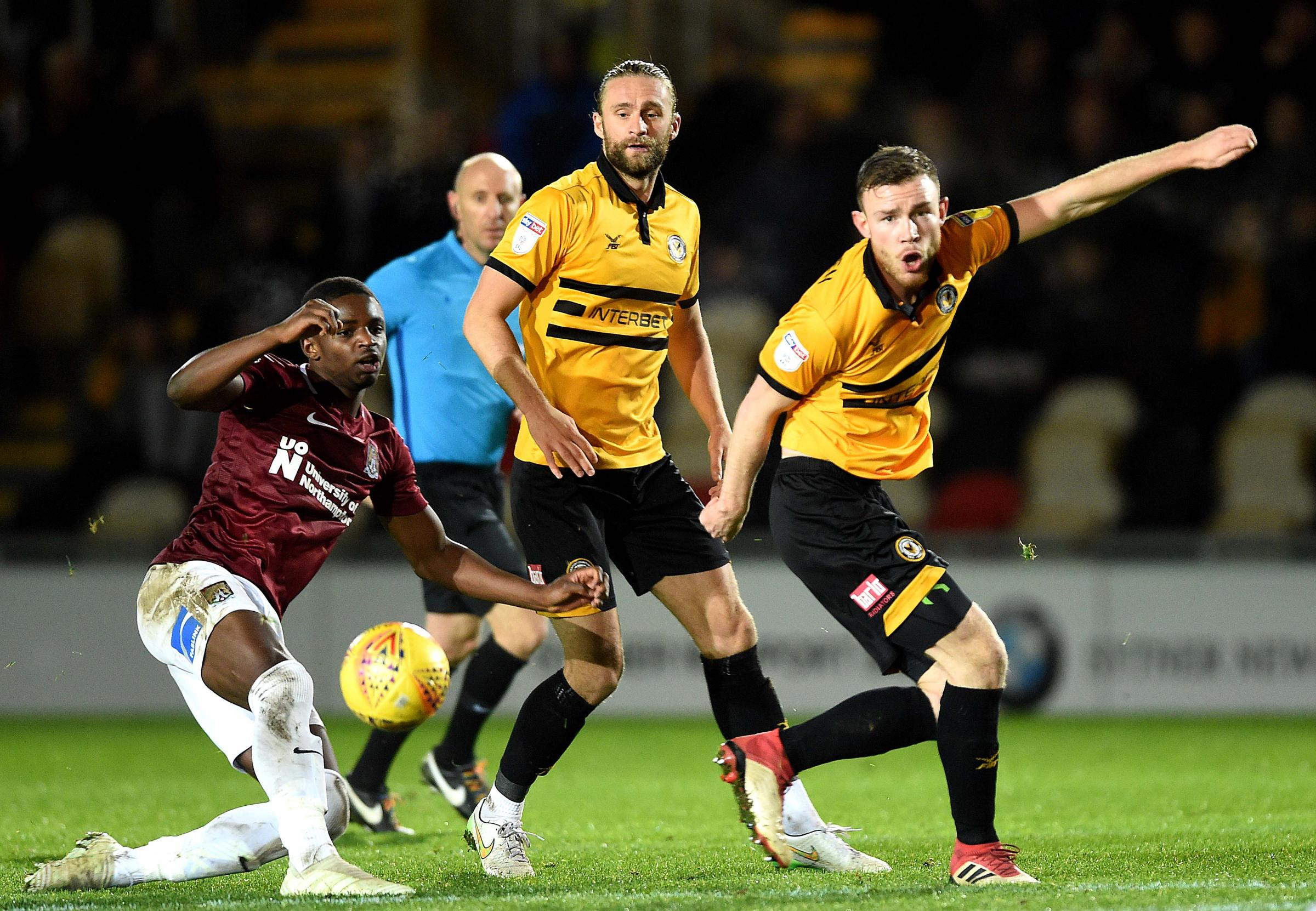 CONTROL: Fraser Franks and Mark O'Brien in action for Newport County against Northampton Town. Pictures: Huw Evans Agency