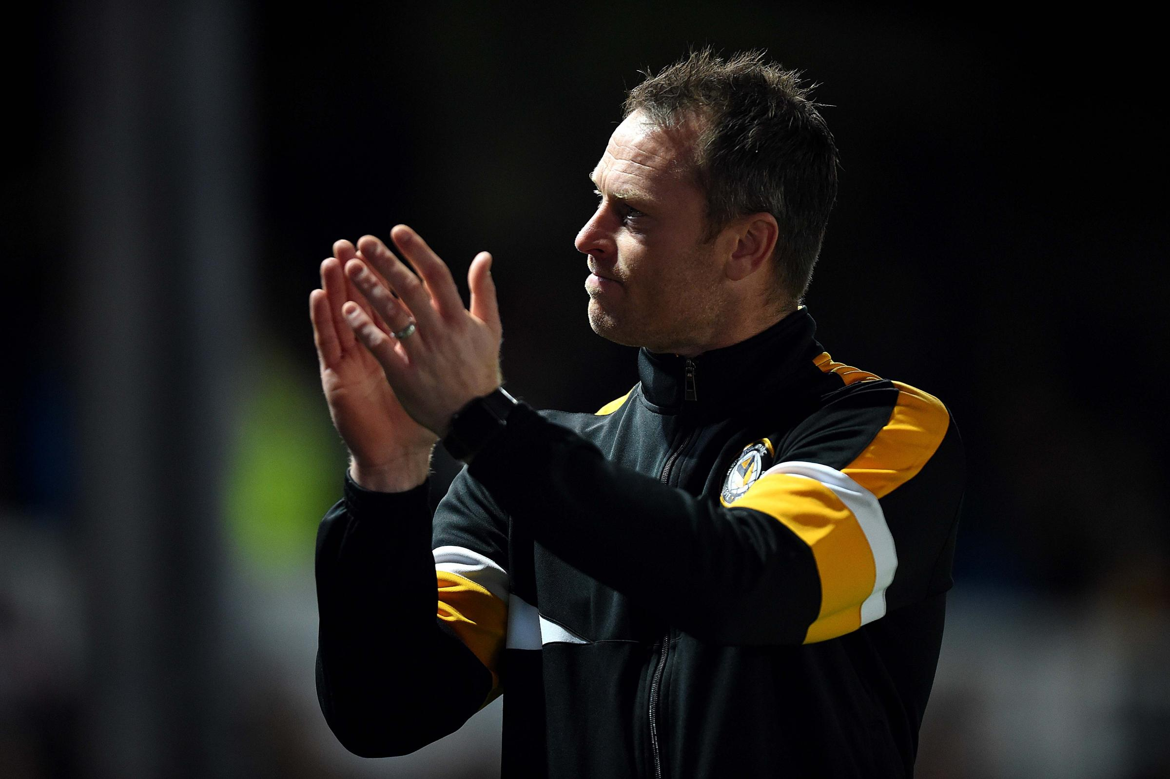 DELIGHTED: Newport County manager Michael Flynn savours a job well done against Northampton Town. Pictures: Huw Evans Agency