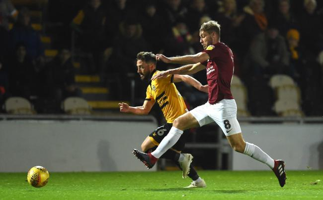 TALENT: Newport County midfielder Josh Sheehan gets away from former Exiles ace Sam Foley on Tuesday