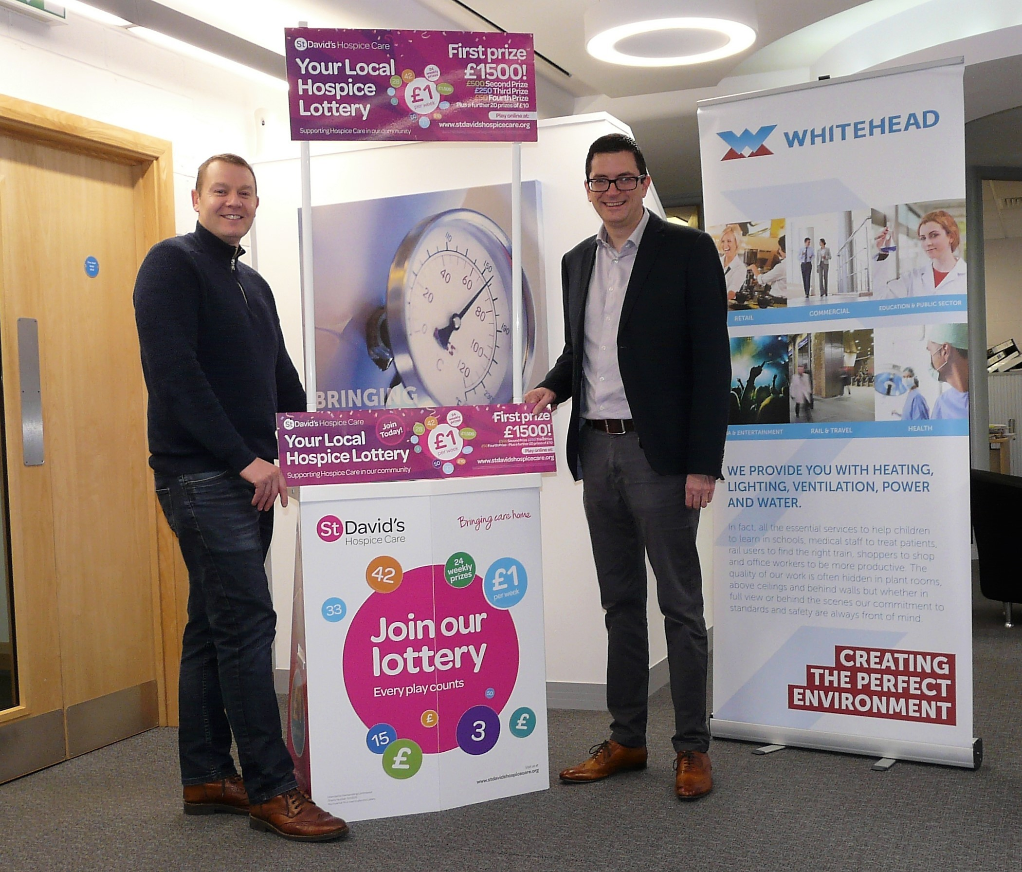 Signed up: Michael Tasker, of Whitehead (right) with Kris Broome of St David's Hospice Care launch the new lottery promotion. Picture: DBPR