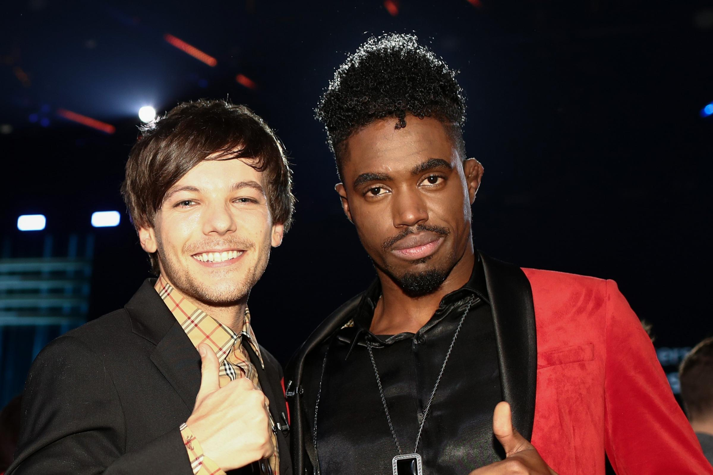 Dalton Harris and judge Louis Tomlinson react after Harris wins The X Factor