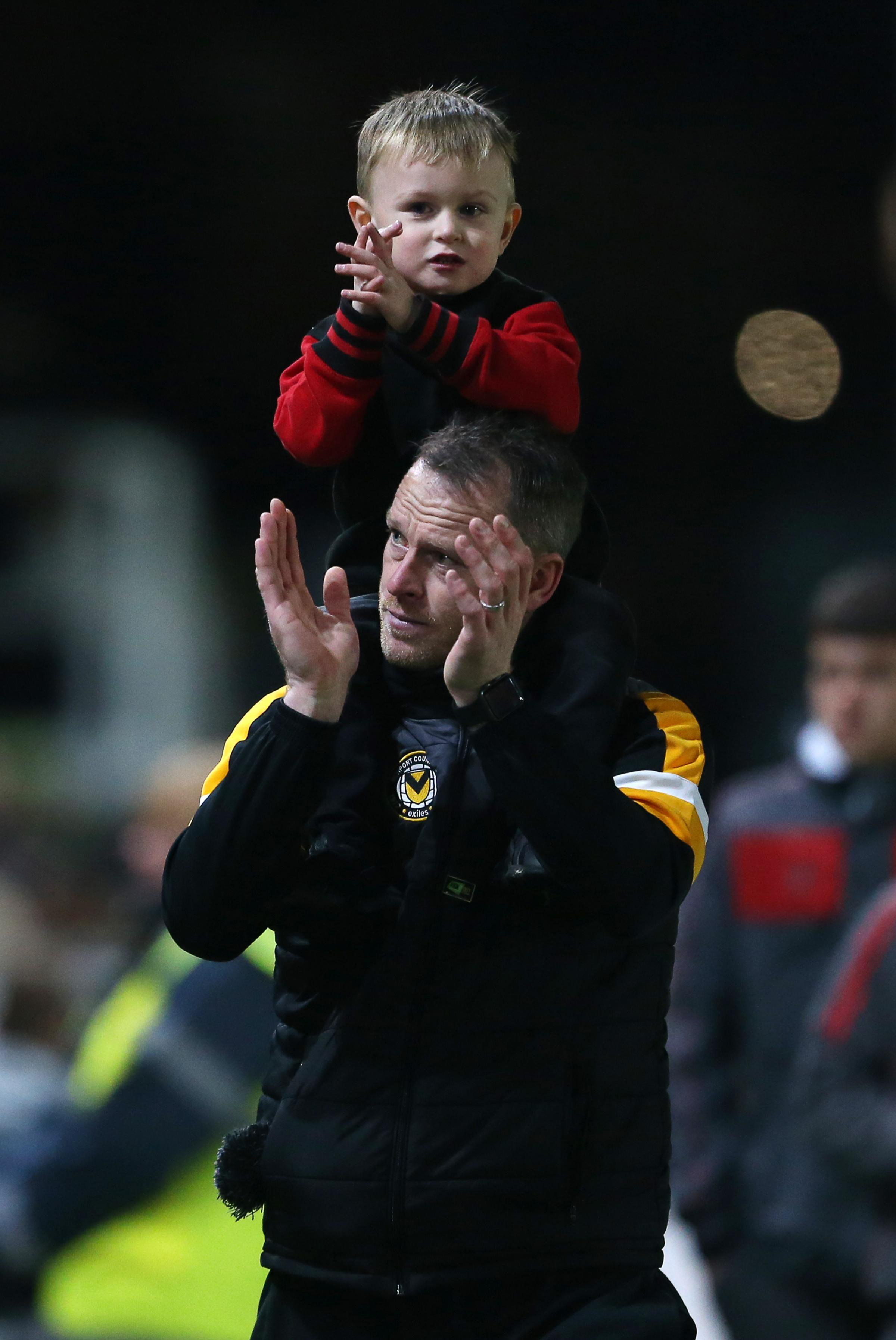 WIN: Michael Flynn celebrates with his son Edward on Tuesday