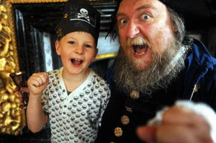 South Wales Argus: Mark Turner, seven, and Goff Morgan as Captain Morgan, at the Tredegar House for the pirate day