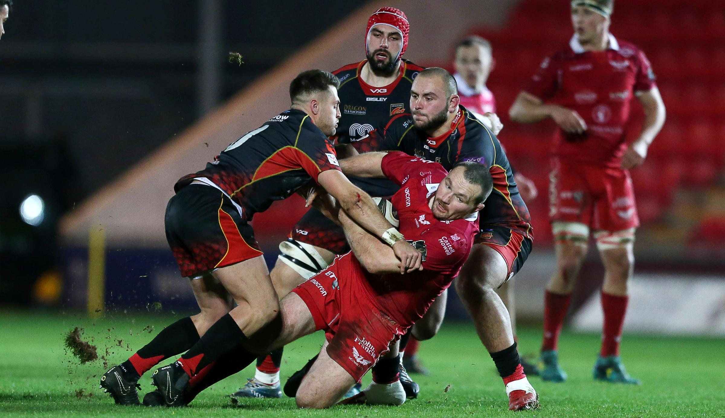 05.01.19 - Scarlets v Dragons - Guinness PRO14 - Ken Owens of Scarlets is tackled by Josh Lewis and Gerard Ellis of Dragons.