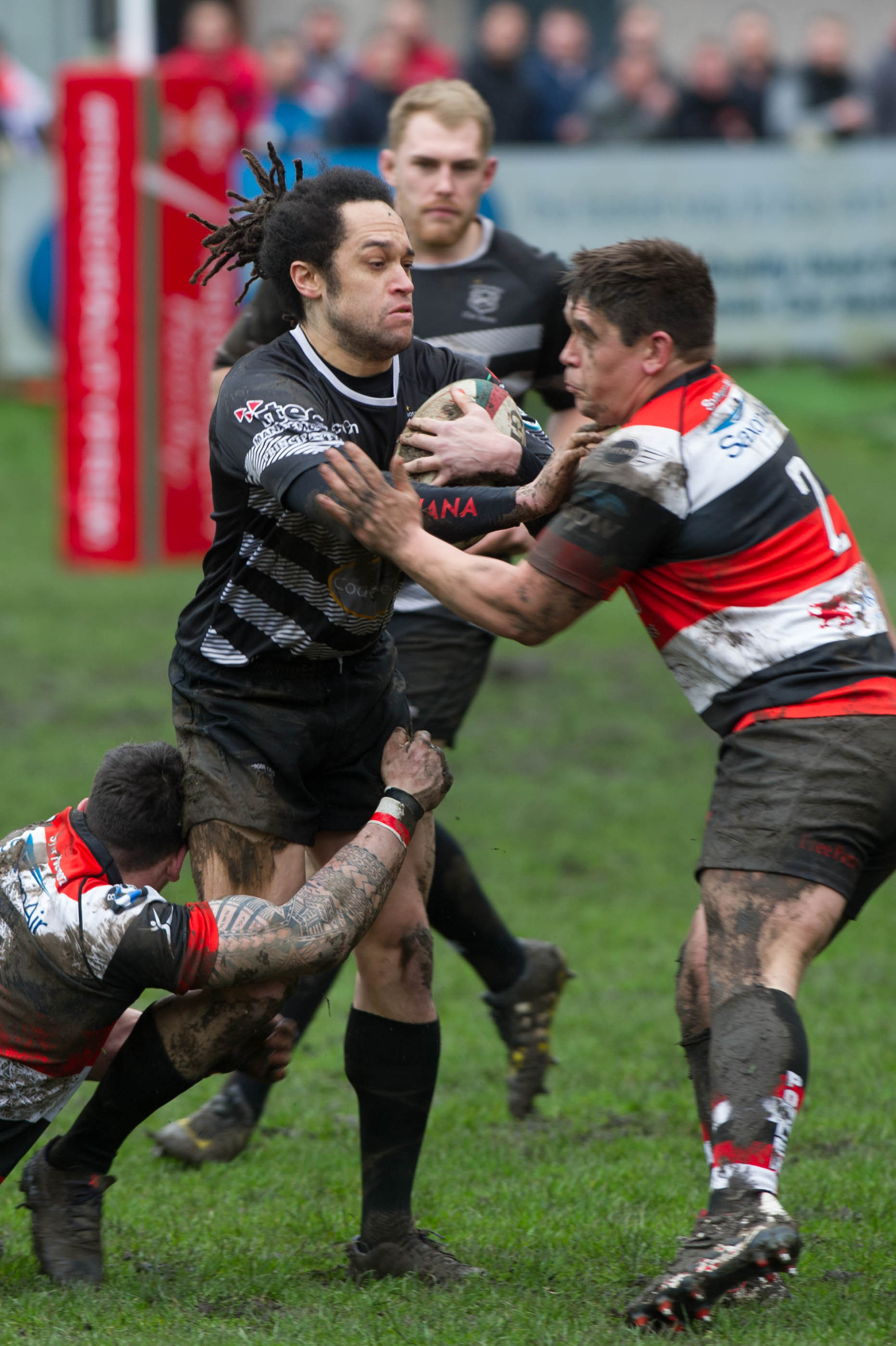CUP CLASH: Leon Andrews is tackled by Ben Parry in the cup game between Cross Keys and Pontypool two years ago