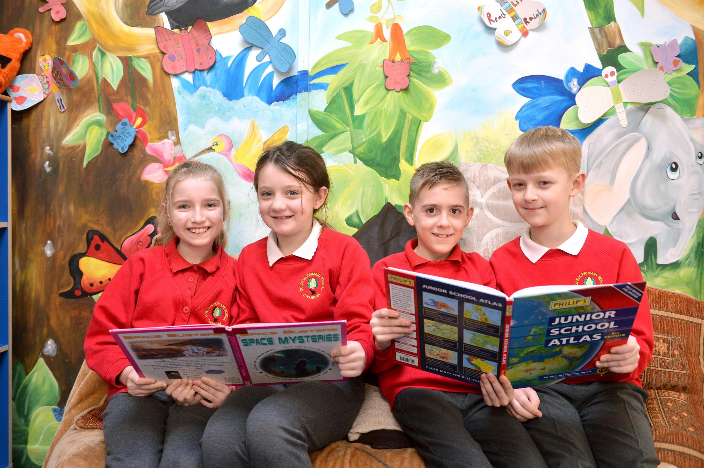 Year 4 reading L-R Ffion Rolph, Alicia Manley, Jake Bennett and George Tavener at Coed Eva Primary who are school of the week . www.christinsleyphotography.co.uk