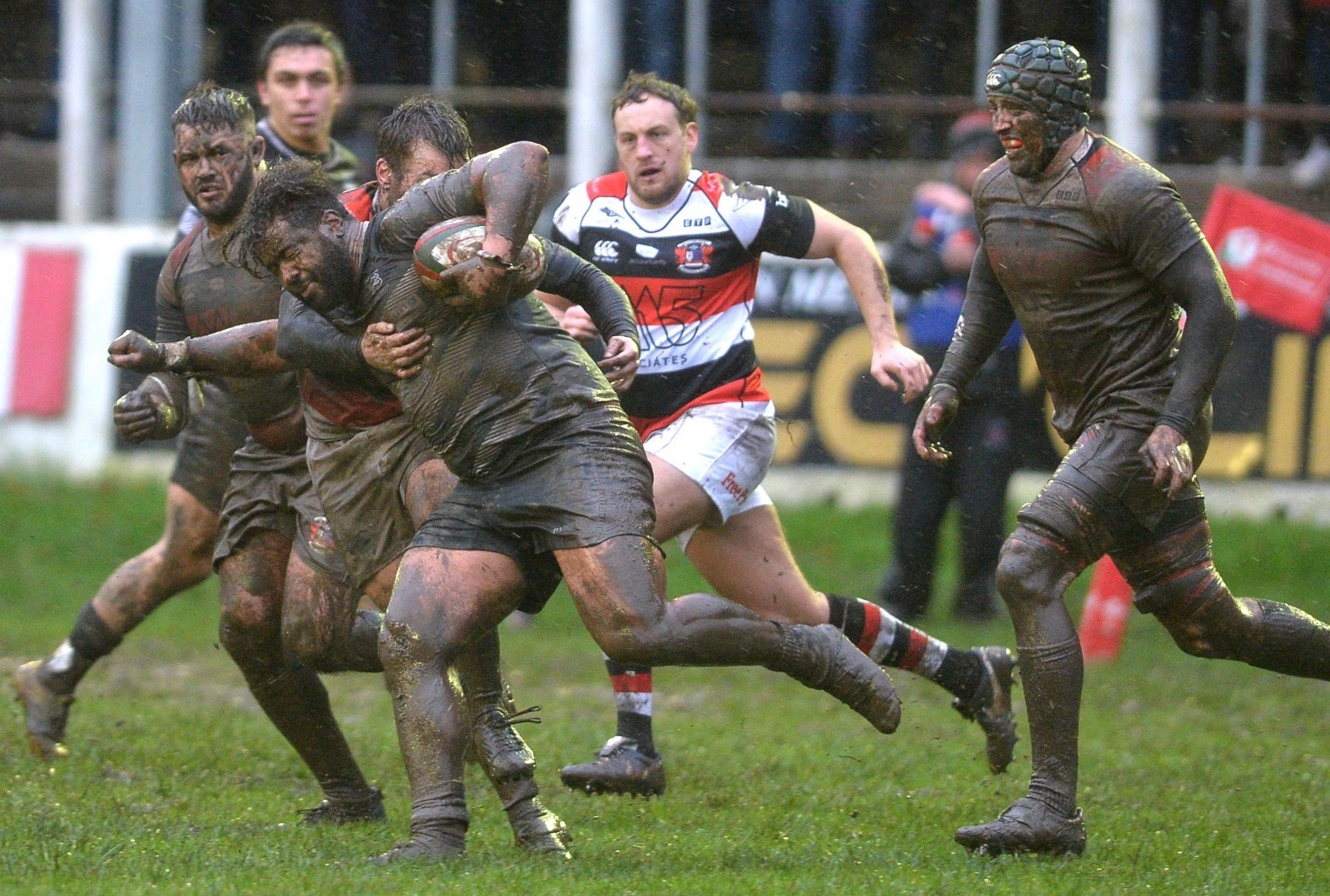 CUP CLASH: A muddied Wes Cunliffe leads the charge for Cross Keys in last weekend's cup defeat to Pontypool