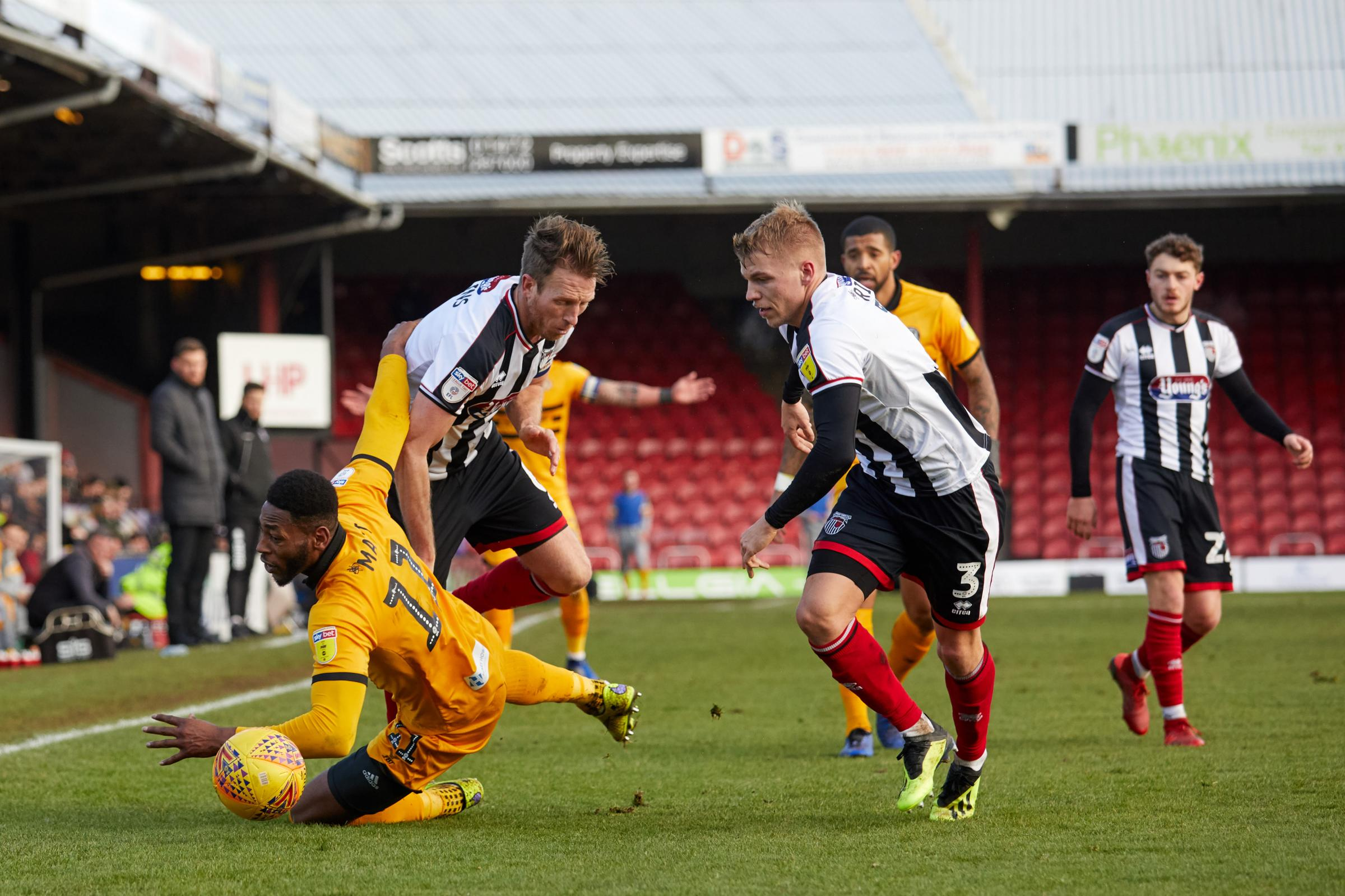 DOWN: Newport County striker Jamille Matt takes a tumble at Grimsby Town. Pictures: Huw Evans Agency