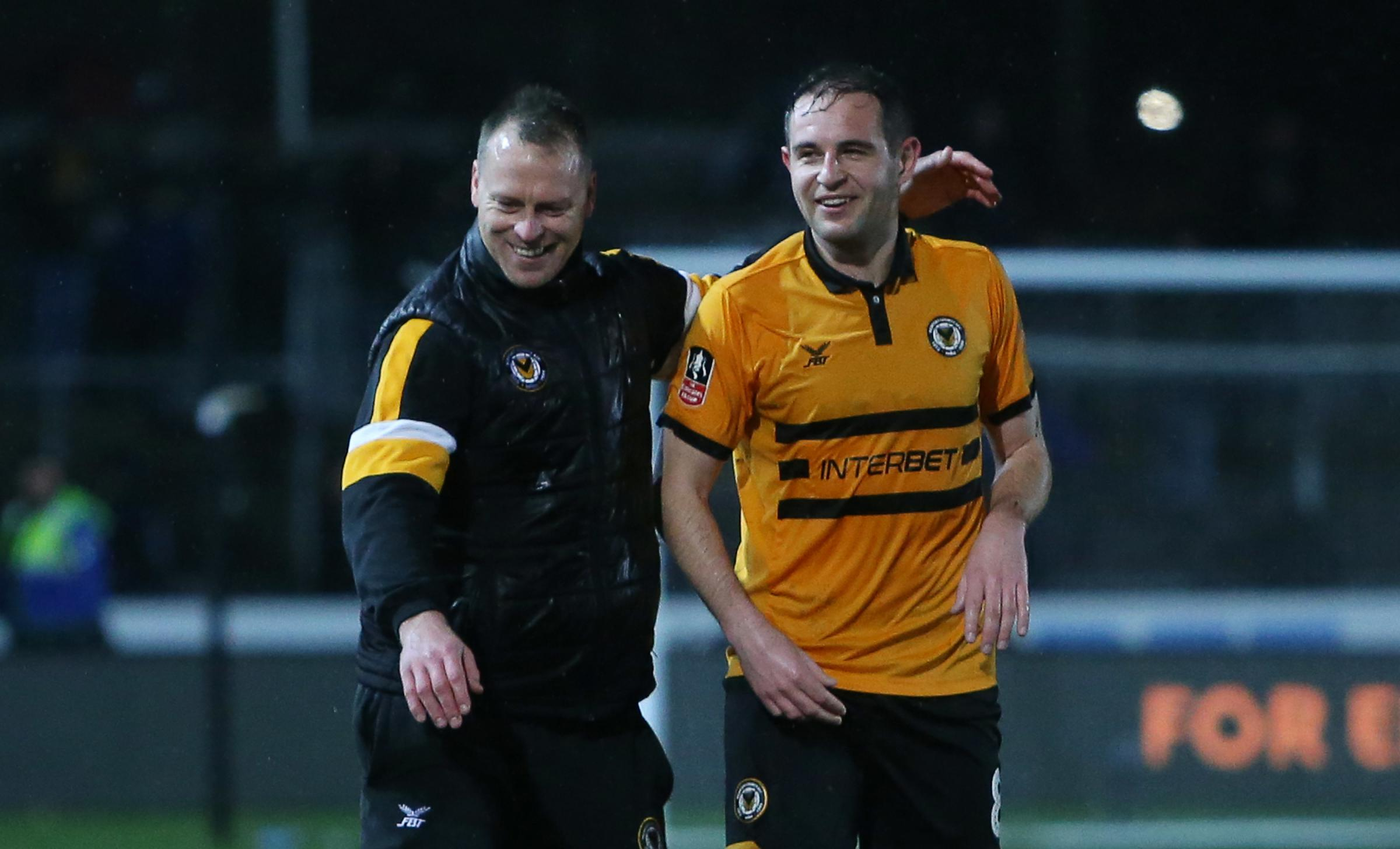VICTORY: Newport County manager Michael Flynn and Matty Dolan celebrate the win over Middlesbrough. Pictures: Huw Evans Agency