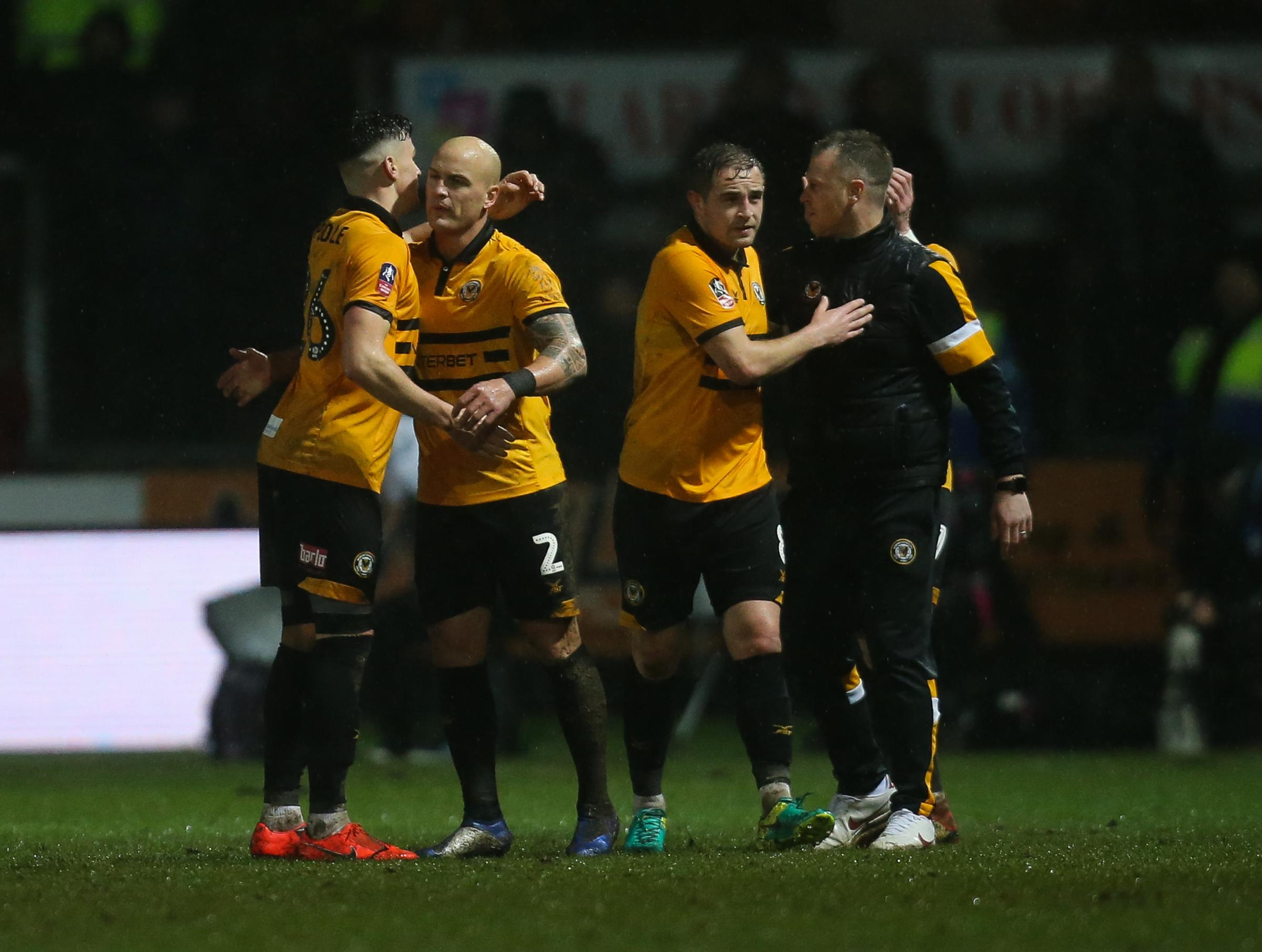 JOY: David Pipe, second left, celebrates with teammates and boss Michael Flynn on Tuesday night