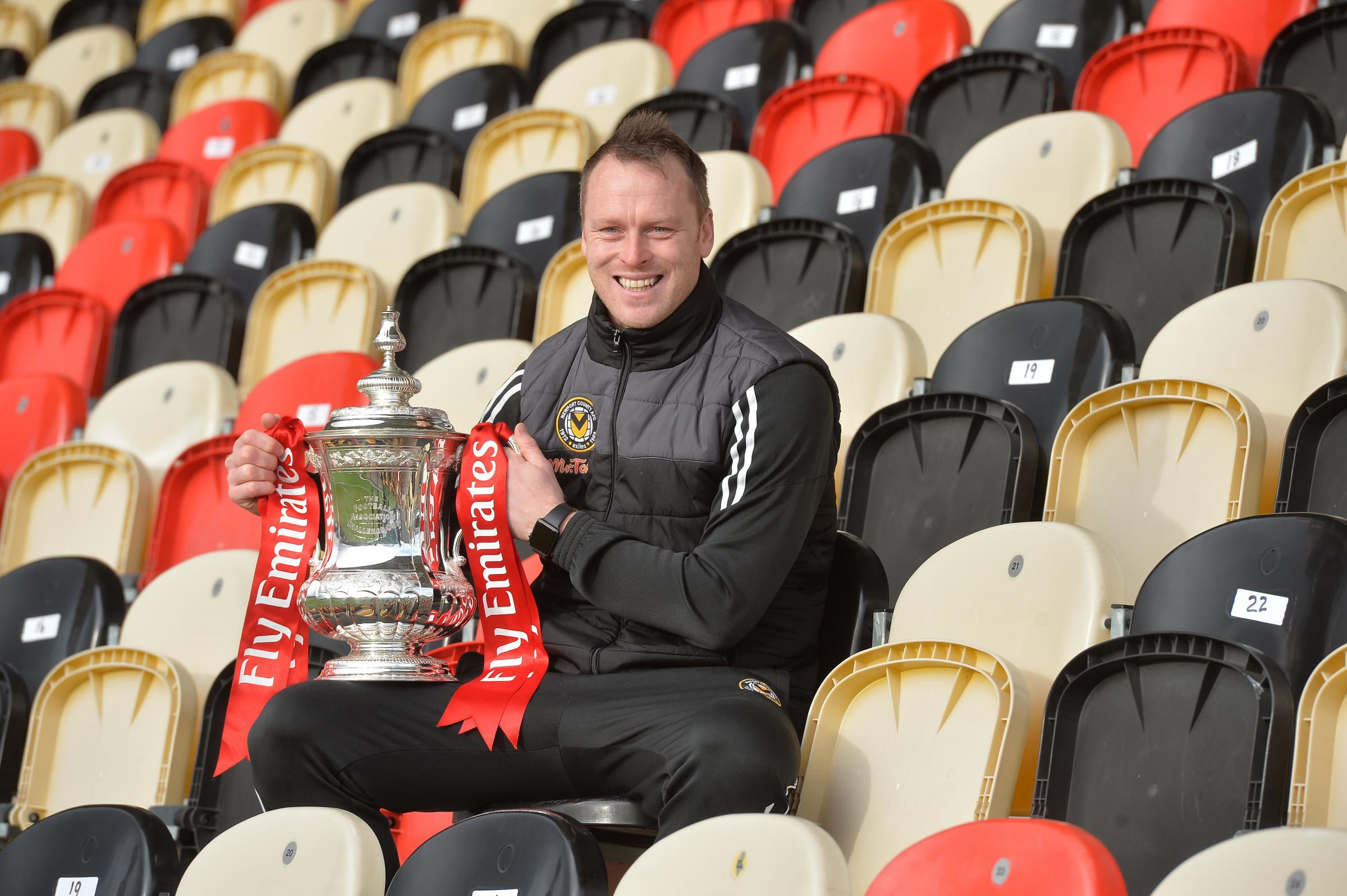 EXCITED: Newport County manager Michael Flynn with the FA Cup. Picture: www.christinsleyphotography.co.uk.