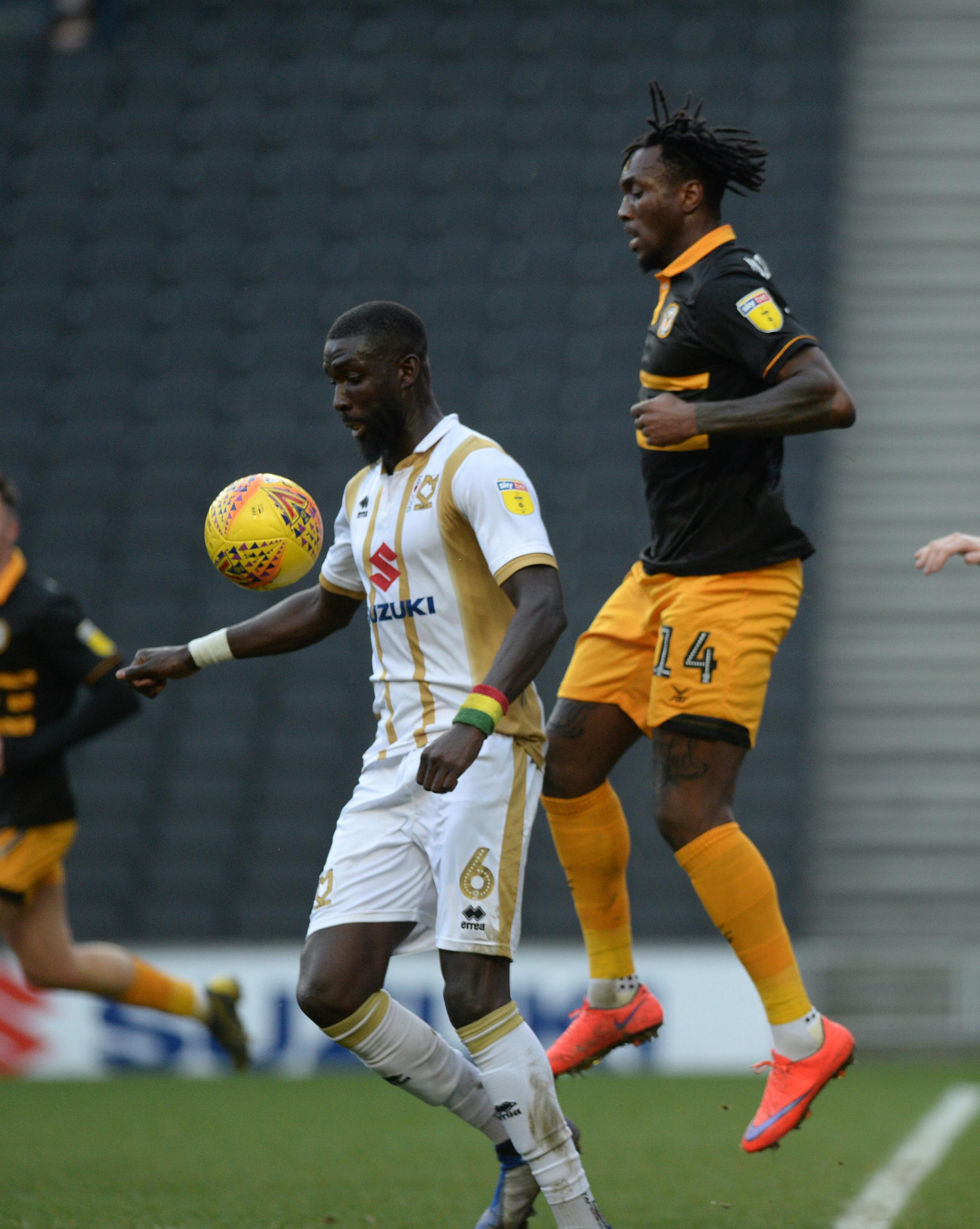 DEBUT: Newport County striker Ade Azeez, right, in action at MK Dons last week