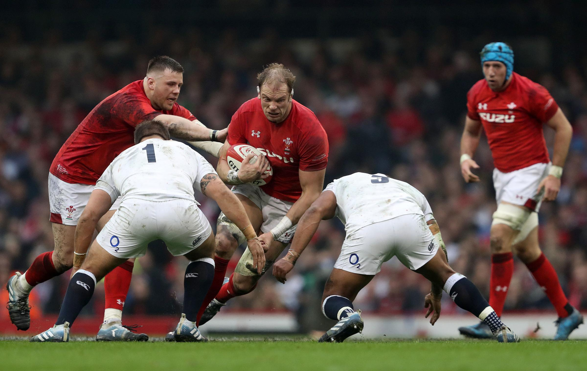 Wales' Alun Wyn Jones (centre) is tackled by England's Ben Moon (left) and Kyle Sinckler during the Guinness Six Nations match at the Principality Stadium, Cardiff. PRESS ASSOCIATION Photo. Picture date: Saturday February 23, 2019. See PA story R