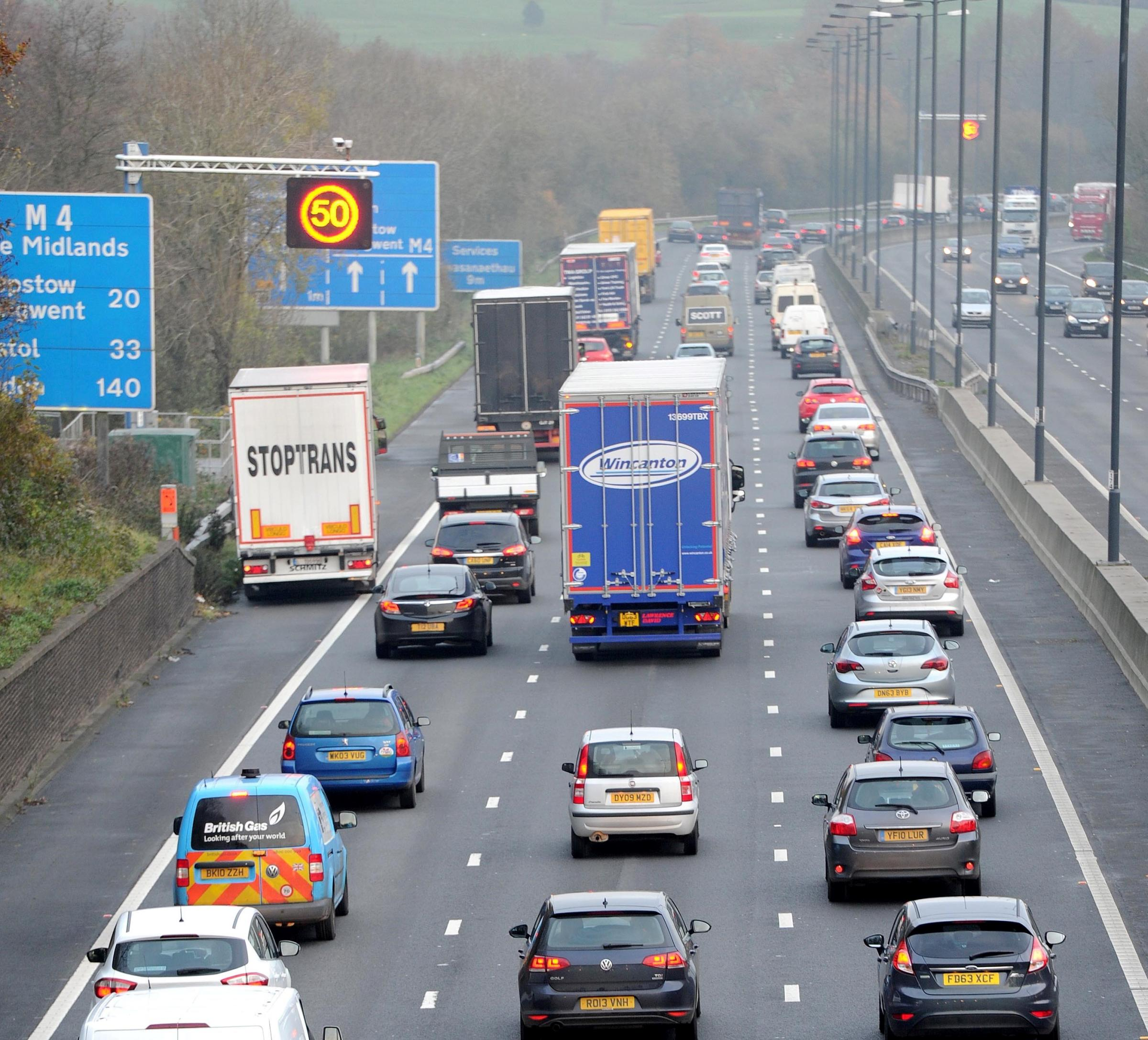 Variable speed limit. Traffic on the M4 during morning rush hour, Newport.