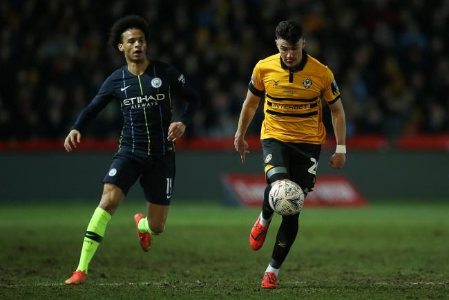 AMBITION: Regan Poole in action for Newport County against Leroy Sane of Manchester City