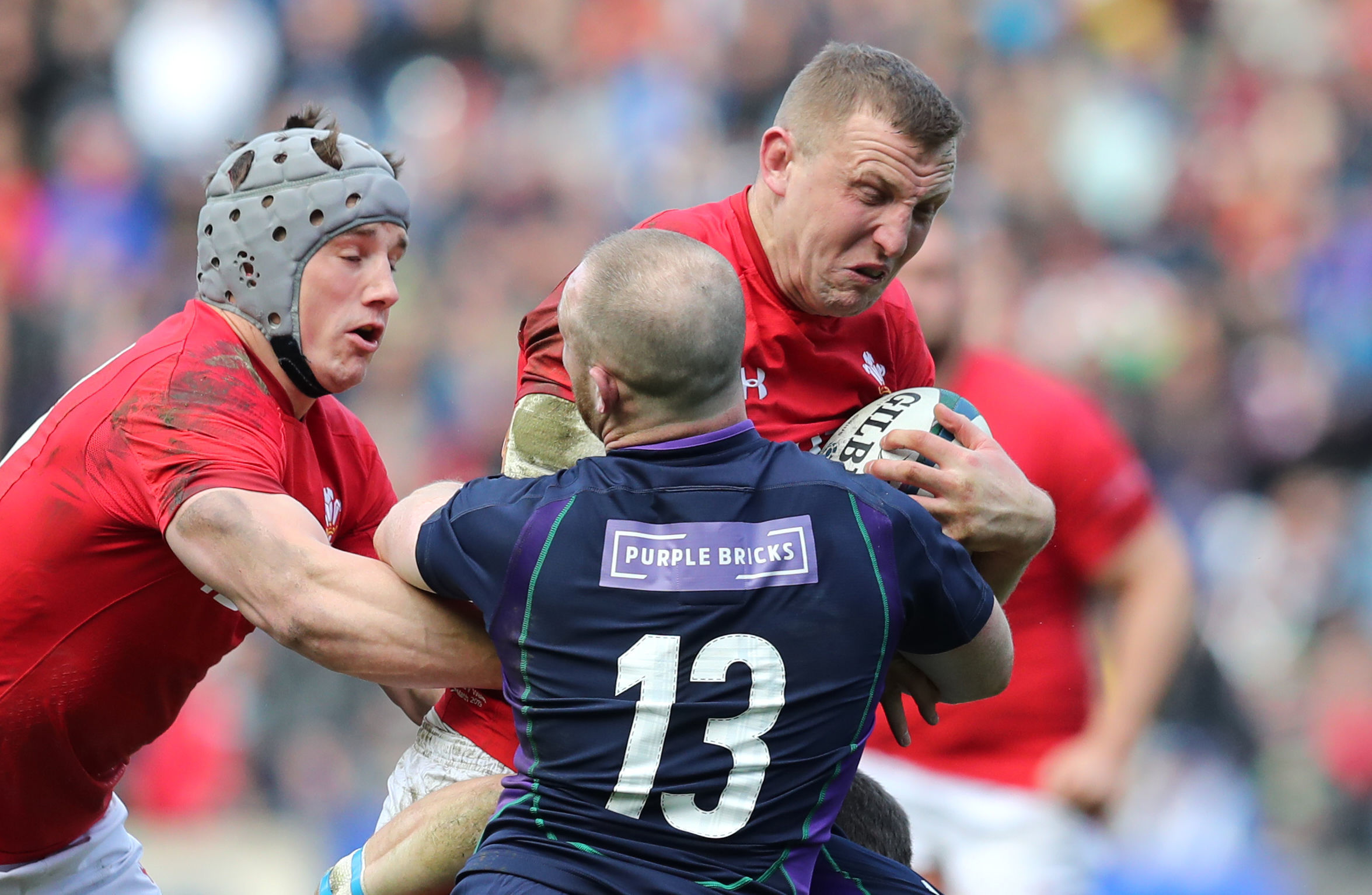 BRUISING BATTLE: Centre Hadleigh Parkes was left bloodied after leading the charge for Wales in Scotland