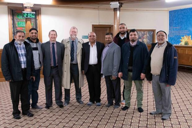 South Wales Argus: Gwent's police and crime commissioner Jeff Cuthbert (fourth from left) and chief constable Julian Williams (third from left) with members of Newport's muslim community at the mosque on Victoria Road.