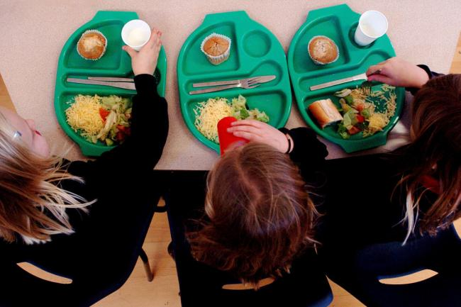 PARENTAL PERMISSION OBTAINED. File photo dated 08/03/07 of a generic picture of pupils enjoying school dinners as concerns were being raised today about the Government's ability to afford a £1 billion giveaway handing all children under e