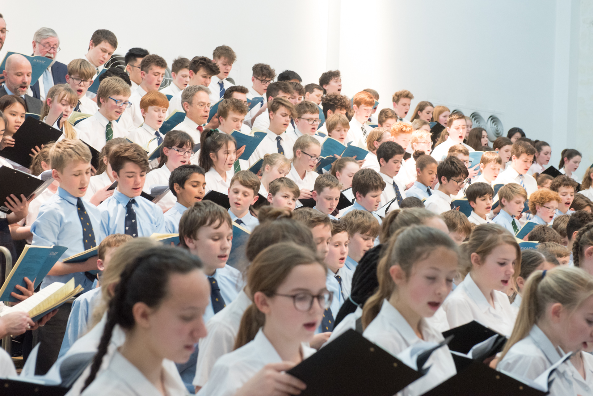 Hundreds of schoolchildren raise the roof in concert involving numerous unusual objects