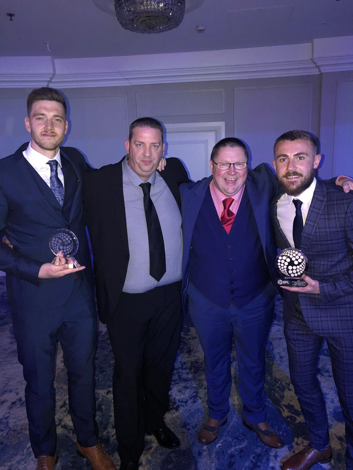 WINNERS: Joe Day, left, and Dan Butler, right with directors Colin Faulkner and Gavin Foxall at Sunday's EFL Awards. Picture: Newport County AFC