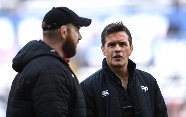 SHARING KNOWLEDGE: Dragons head coach Ceri Jones (left) and Ospreys head coach Allen Clarke talking at last month's derby