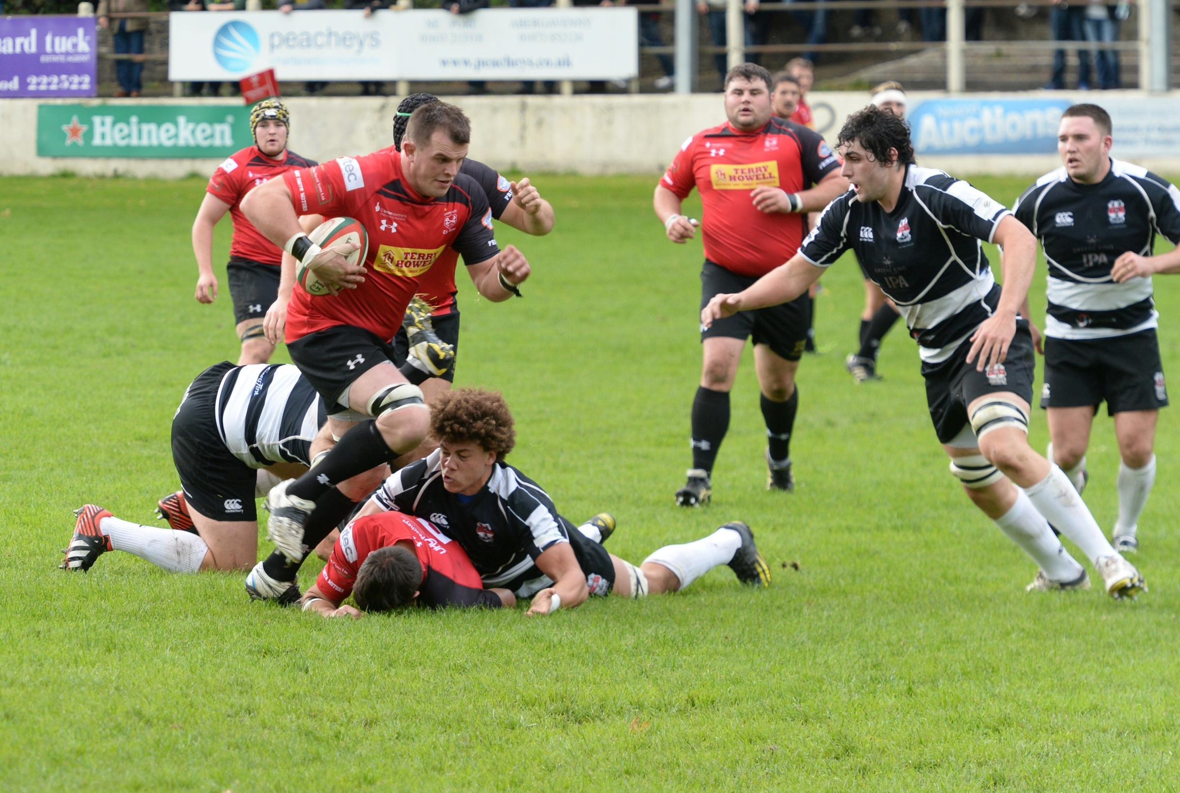 EARLY DAYS: Cory Hill (right), now a Wales lock, closes in on Danny Hodge in the game between Moseley and Cross Keys in 2013