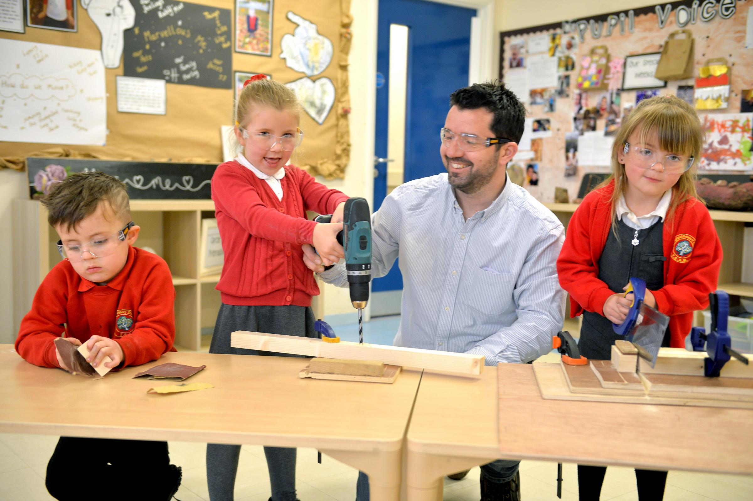 Youngsters use power tools to build puppet theatre as part of creative arts project